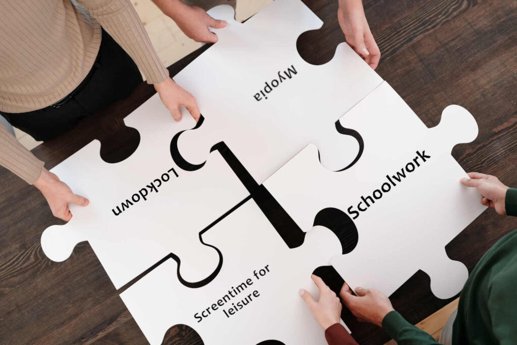 fitting together giant puzzle pieces with the words 'lockdown' 'myopia' 'screentime for leisure' and 'schoolwork'