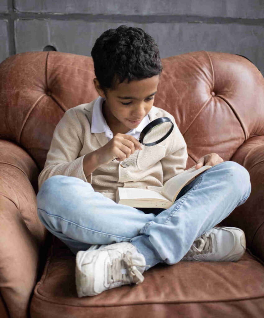 lockdown vision problems boy with magnifying glass reads book